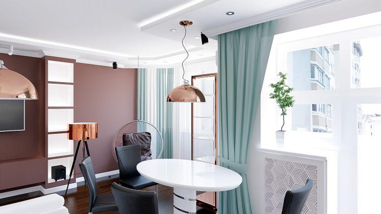 интерьер квартиры в Гомеле, Зона кухни-гостиной-прихожая, белый диван, темно-коричневая стена, полки с подсветкой, подвесные светильники, обеденной в современном стиле