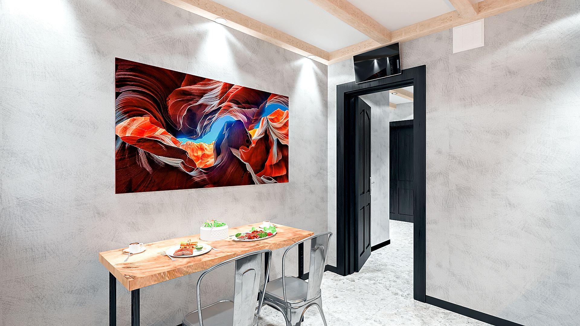 Дизайн однокомнатной квартиры в Гомеле, кухня в стиле лофт в квартире изображение 11, вид на обеденный стол, маленький телевизор над дверным проемом, картина над обеденным столом