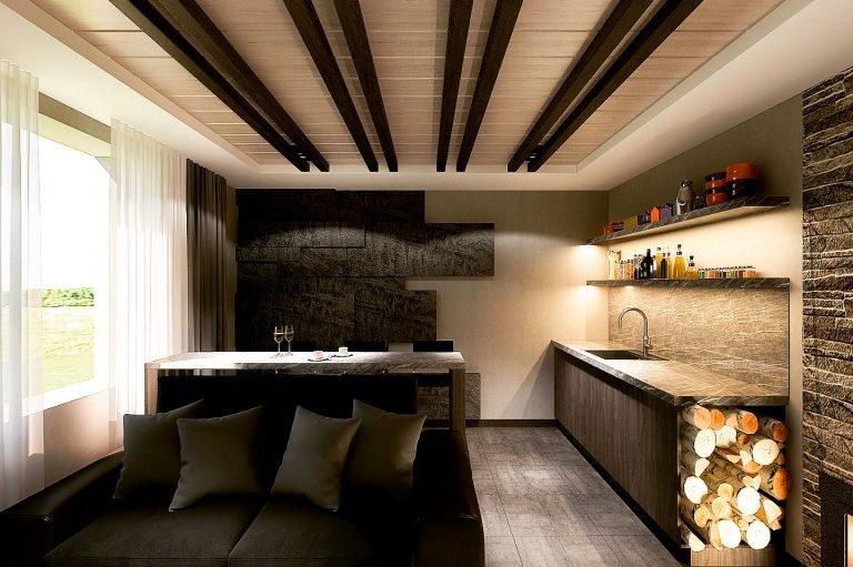 интерьер комнаты отдыха в бане, вид на декоративные настенные панели, барная стойка, диван, кухонный гарнитур, банная печь