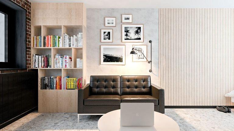однокомнатная квартира в Гомеле, Гостиная - спальня в стиле лофт в квартире изображение 7, вид на диван панно из картин с светильник на кронштейне
