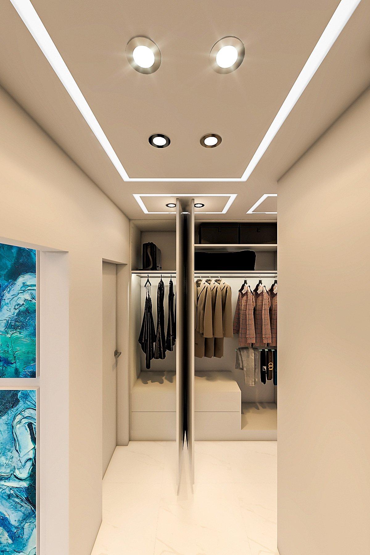 шкаф для одежды в коридоре в однокомнатной квартире в минске, вид с отрытыми дверцами с подсветкой и наполнением шкафа