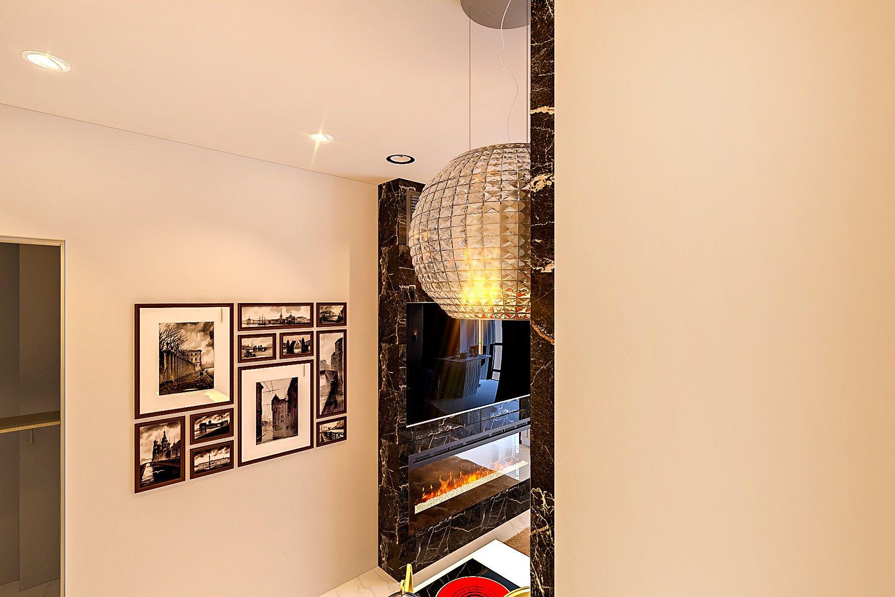 вид из зоны кухни на красивую вытяжку над варочной панелью, и зону гостиной с камином, телевизором