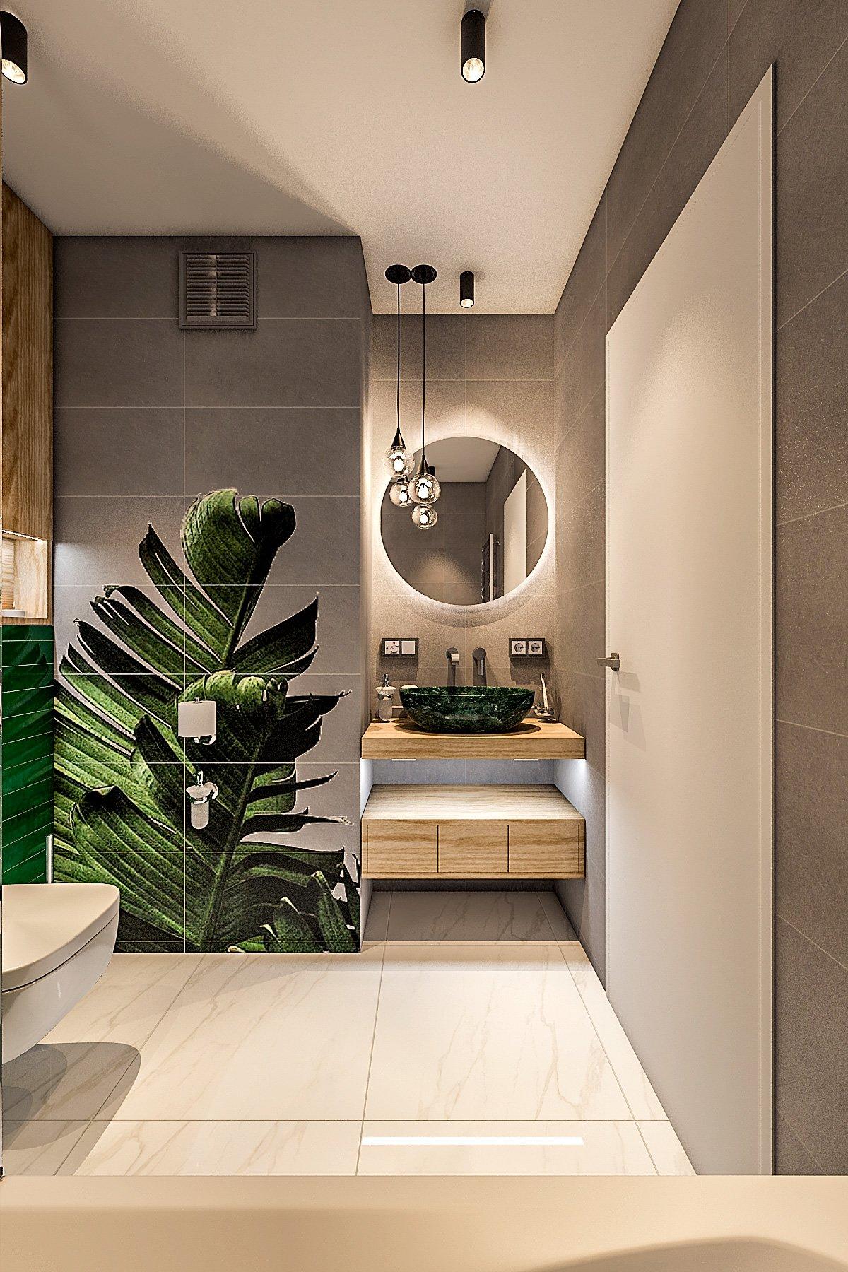 """дизайн санузла в современном стиле, круглое зеркало с подсветкой, раковина зеленая на столешнице, принт на плитке """"банановые листья"""""""
